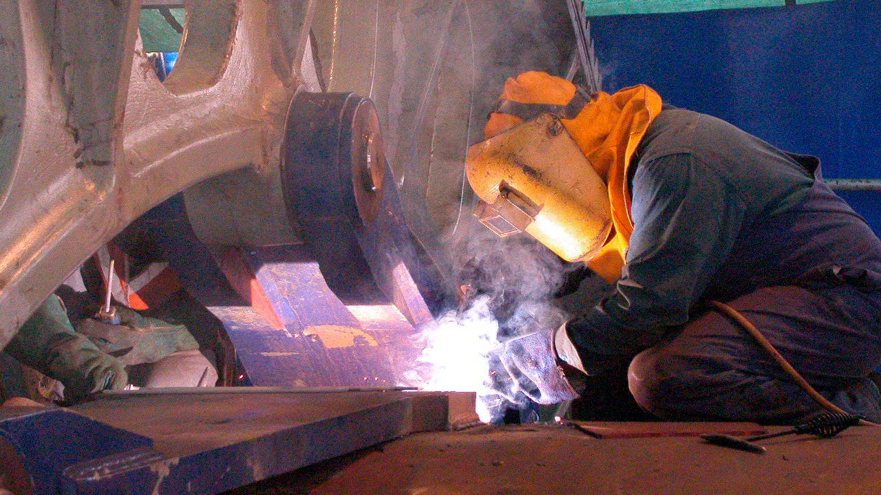Welding girth gear tangent plates to kiln shell